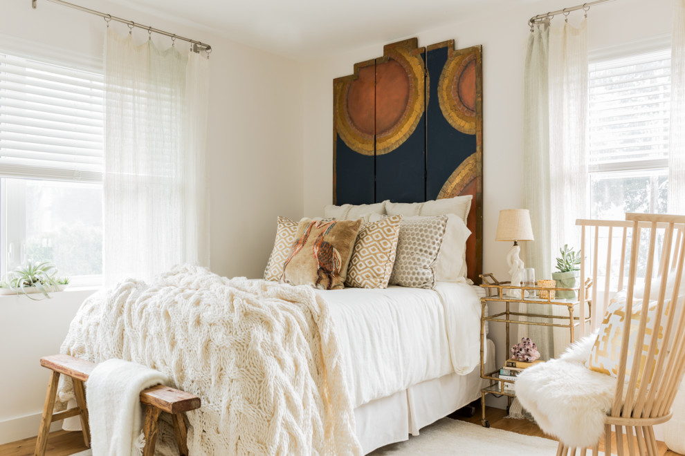 Bedroom - eclectic medium tone wood floor bedroom idea in Boston with white walls and no fireplace