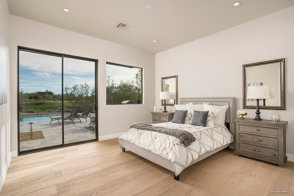Mid-sized trendy guest light wood floor bedroom photo in Phoenix with beige walls and no fireplace