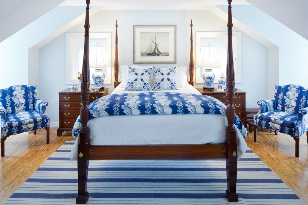 Inspiration for a timeless medium tone wood floor bedroom remodel in Baltimore with blue walls