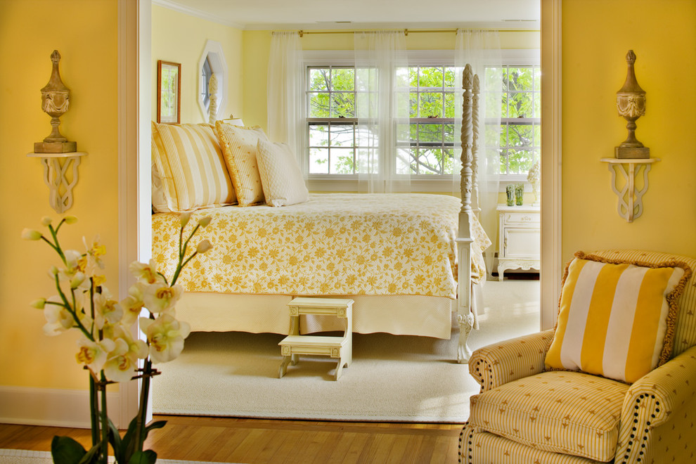 Example of a classic bedroom design in Baltimore with yellow walls