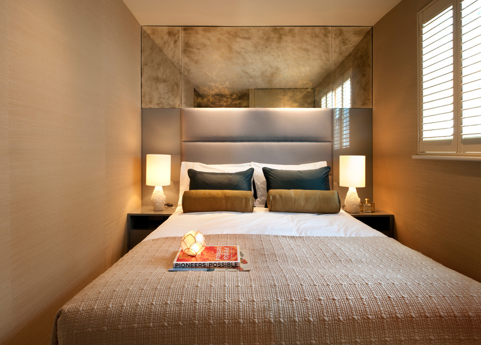 Inspiration for a small contemporary bedroom remodel in London with beige walls