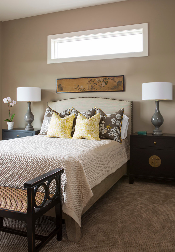 Example of a transitional carpeted bedroom design in Minneapolis with brown walls