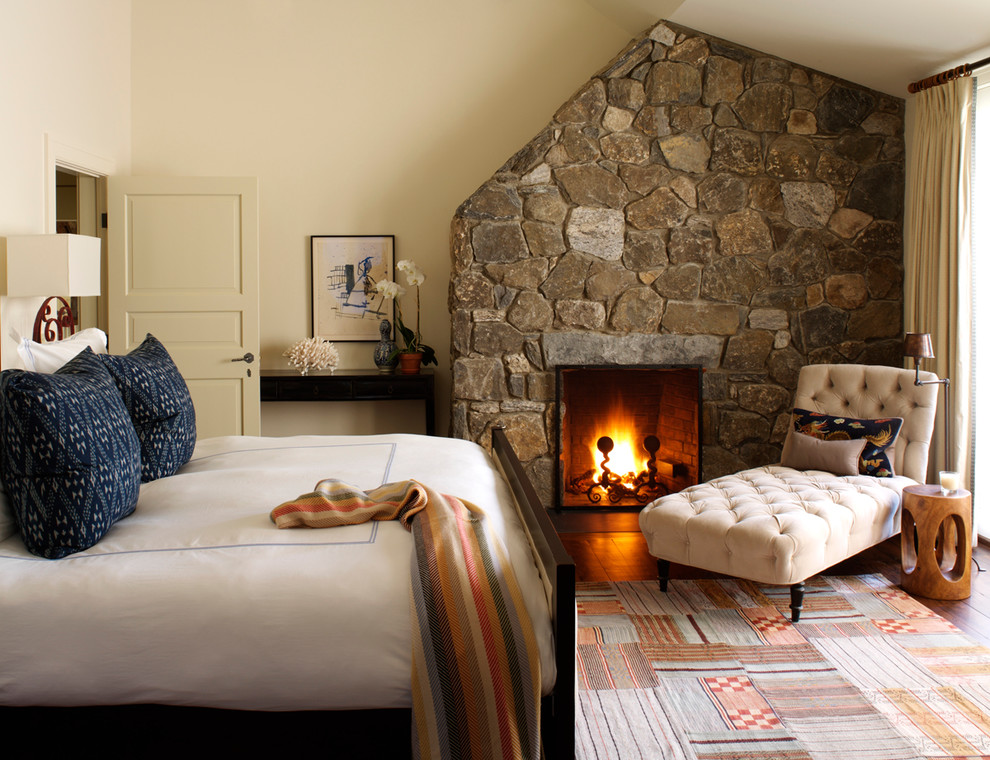 Bedroom - traditional bedroom idea in New York with beige walls, a standard fireplace and a stone fireplace