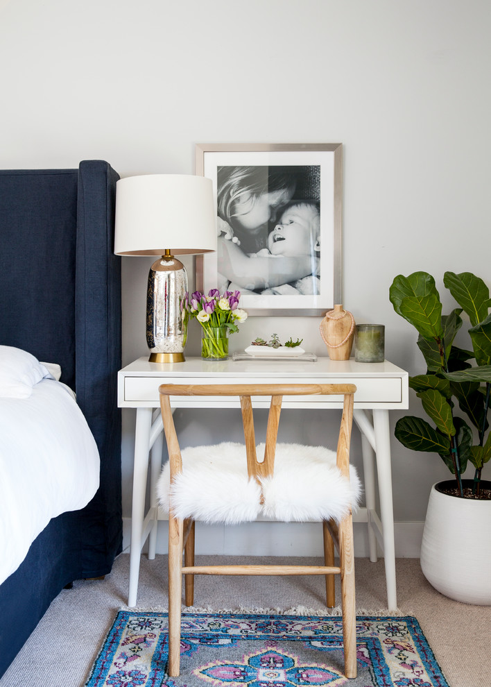 Inspiration for a mid-sized transitional master carpeted and beige floor bedroom remodel in Sacramento with gray walls