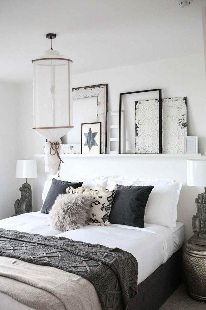 Bedroom - mid-sized shabby-chic style bedroom idea in Surrey with white walls