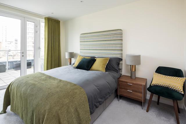 Idées déco pour une petite chambre contemporaine avec un mur blanc, aucune cheminée et un sol gris.
