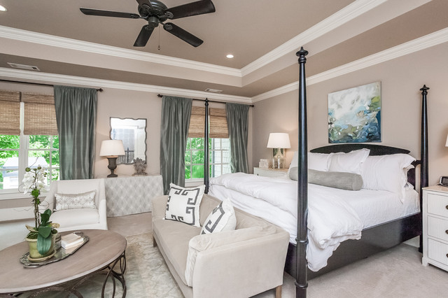 Example of a large classic master carpeted bedroom design in Atlanta with beige walls and no fireplace