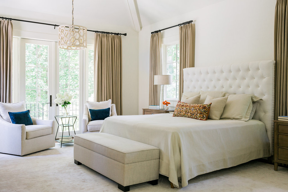 Example of a transitional master carpeted bedroom design in San Francisco with white walls