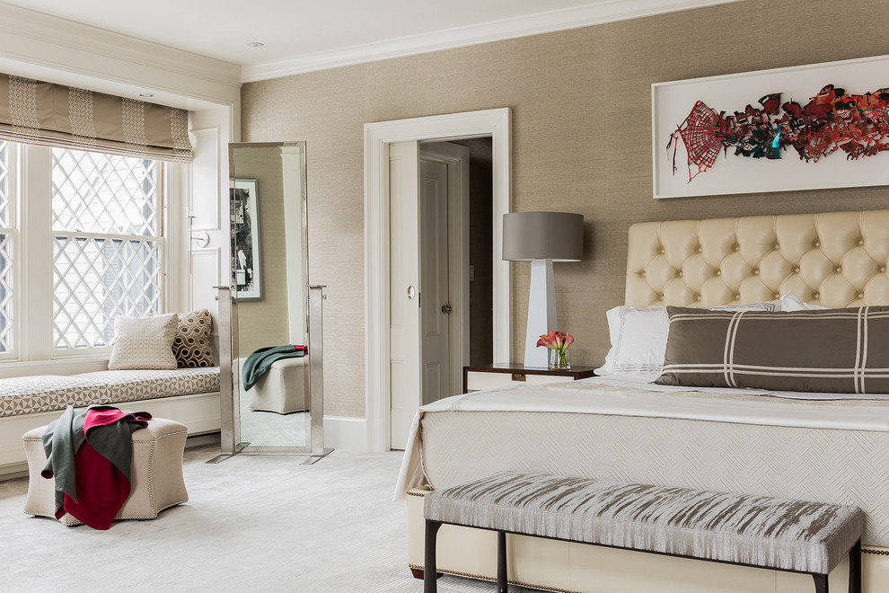 Inspiration for a large transitional master carpeted bedroom remodel in Boston with brown walls