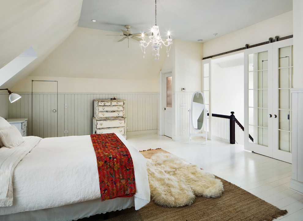 Country painted wood floor and white floor bedroom photo in New York with beige walls