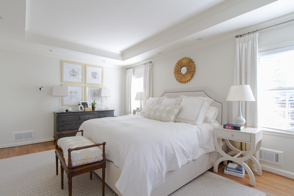 Example of a classic light wood floor bedroom design in Atlanta with white walls