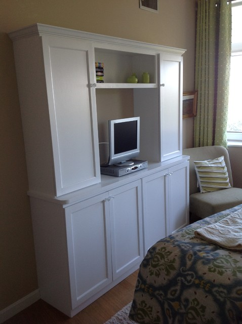 built in bedroom closet with media center traditional bedroom