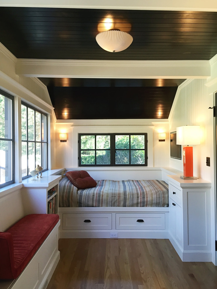 Bedroom - small traditional guest bedroom idea in Milwaukee with white walls
