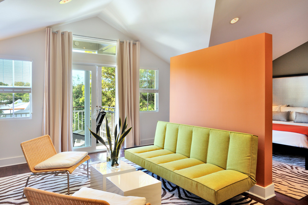 Trendy bedroom photo in Miami with orange walls