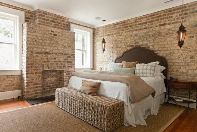 Elegant bedroom photo in Charleston with a brick fireplace