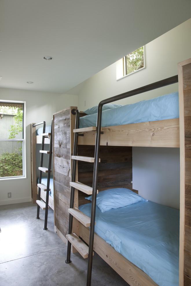 Minimalist concrete floor bedroom photo in Austin