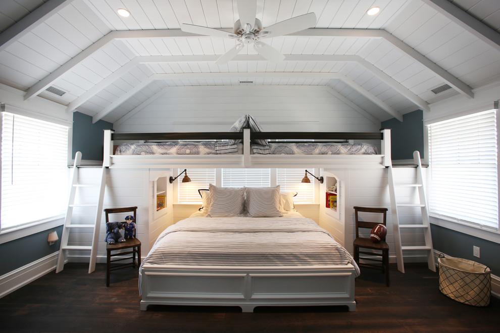 Example of a beach style dark wood floor bedroom design in Philadelphia with blue walls