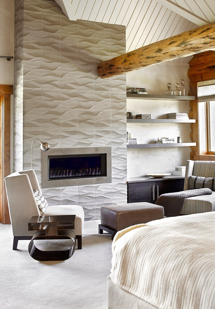 Inspiration for a rustic bedroom in Denver with white walls, carpet, a tiled fireplace surround and a standard fireplace.