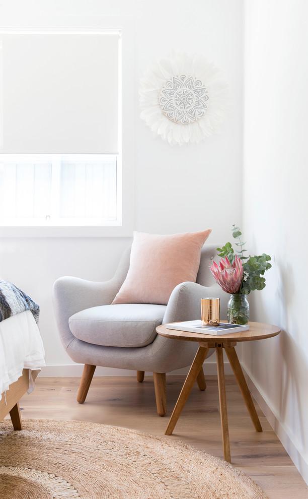 Bedroom - coastal light wood floor bedroom idea in Brisbane with white walls