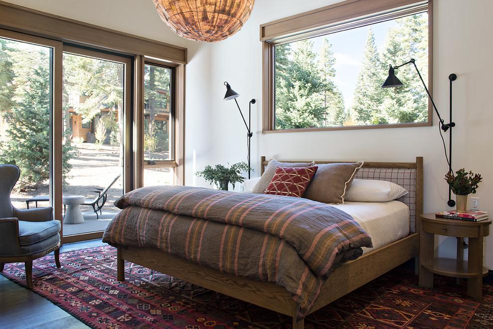 Mountain style dark wood floor bedroom photo in Sacramento with white walls