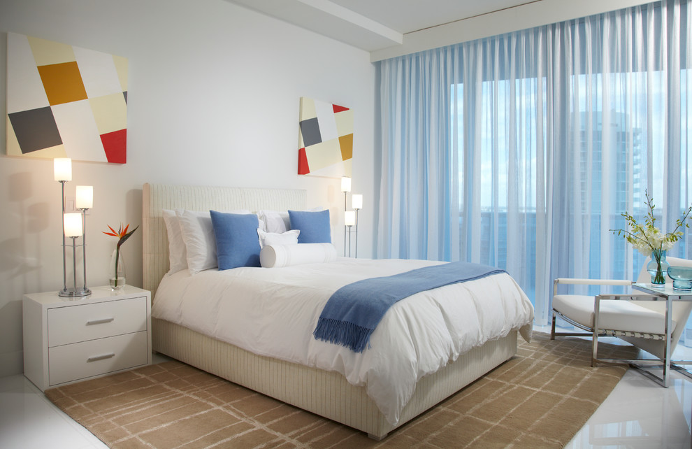 Large trendy guest marble floor and white floor bedroom photo in Miami with white walls