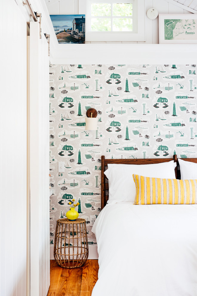 Inspiration for a coastal bedroom remodel in Portland Maine with white walls