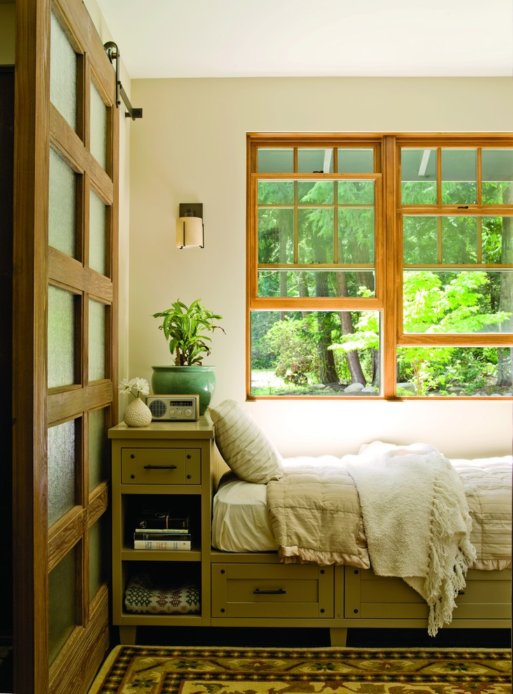 Example of a mid-sized classic guest carpeted and multicolored floor bedroom design in Seattle with beige walls and no fireplace