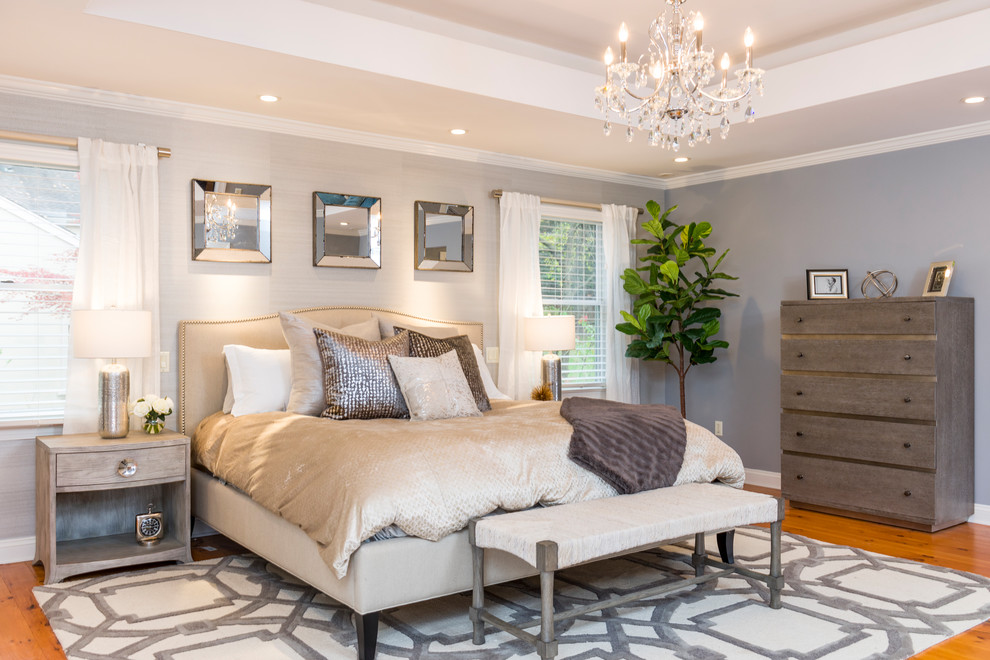 Example of a transitional master medium tone wood floor and brown floor bedroom design in New York with gray walls