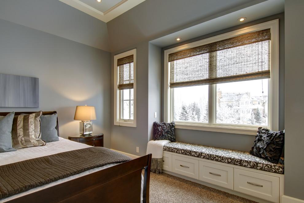 Elegant bedroom photo in Calgary with gray walls