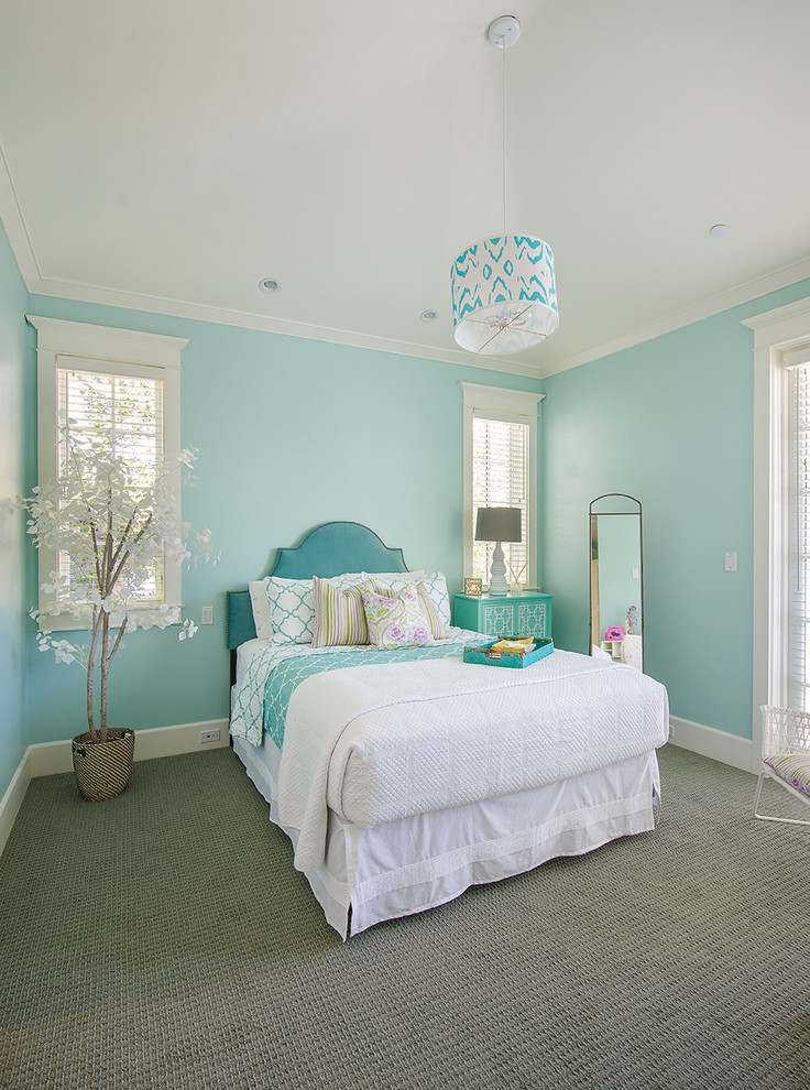 Example of a beach style guest carpeted bedroom design in Los Angeles with blue walls