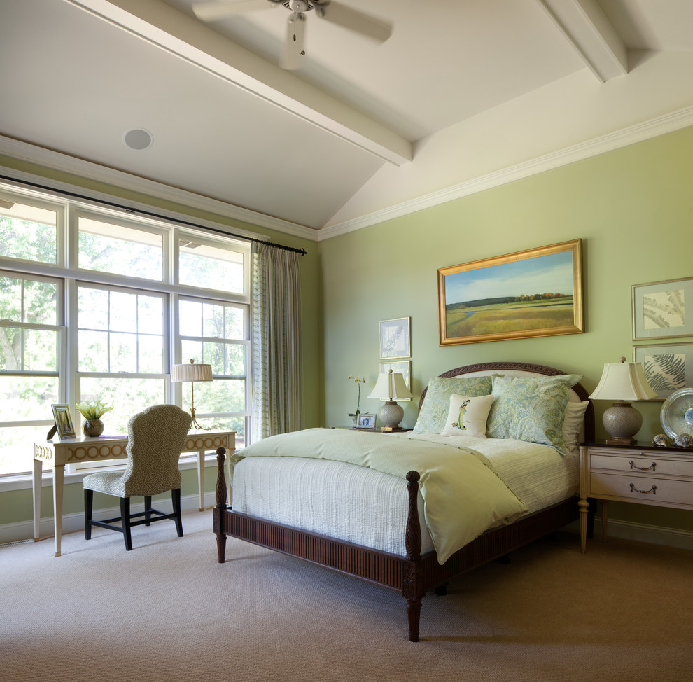 Example of a classic master carpeted bedroom design in Minneapolis with green walls