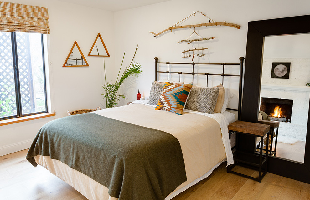 Inspiration for a mid-sized southwestern master medium tone wood floor and brown floor bedroom remodel in Phoenix with white walls