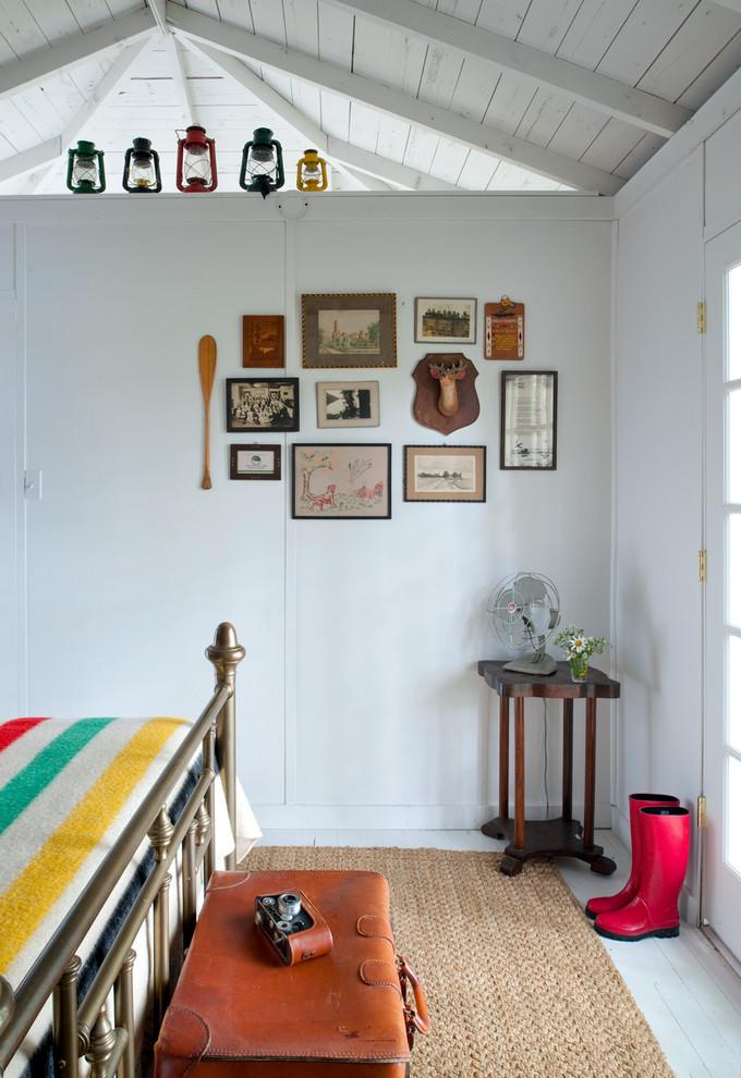 Bedroom - coastal painted wood floor bedroom idea in Chicago with white walls