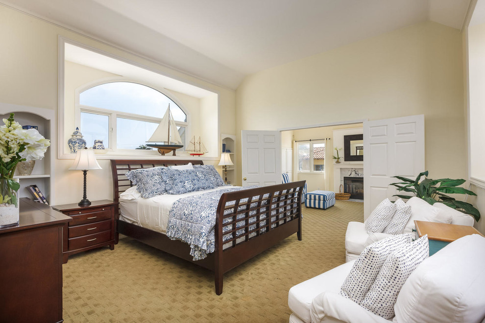 Beach style carpeted bedroom photo in San Diego with beige walls