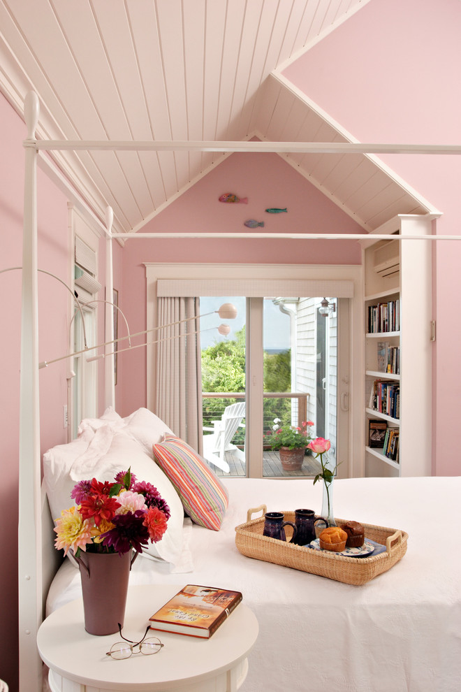 Inspiration for a beach style bedroom remodel in Boston with pink walls