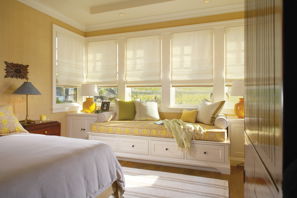 Inspiration for a timeless medium tone wood floor bedroom remodel in Orange County with beige walls and no fireplace