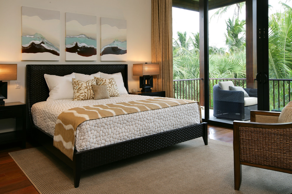 Inspiration for a tropical bedroom remodel in Miami with white walls