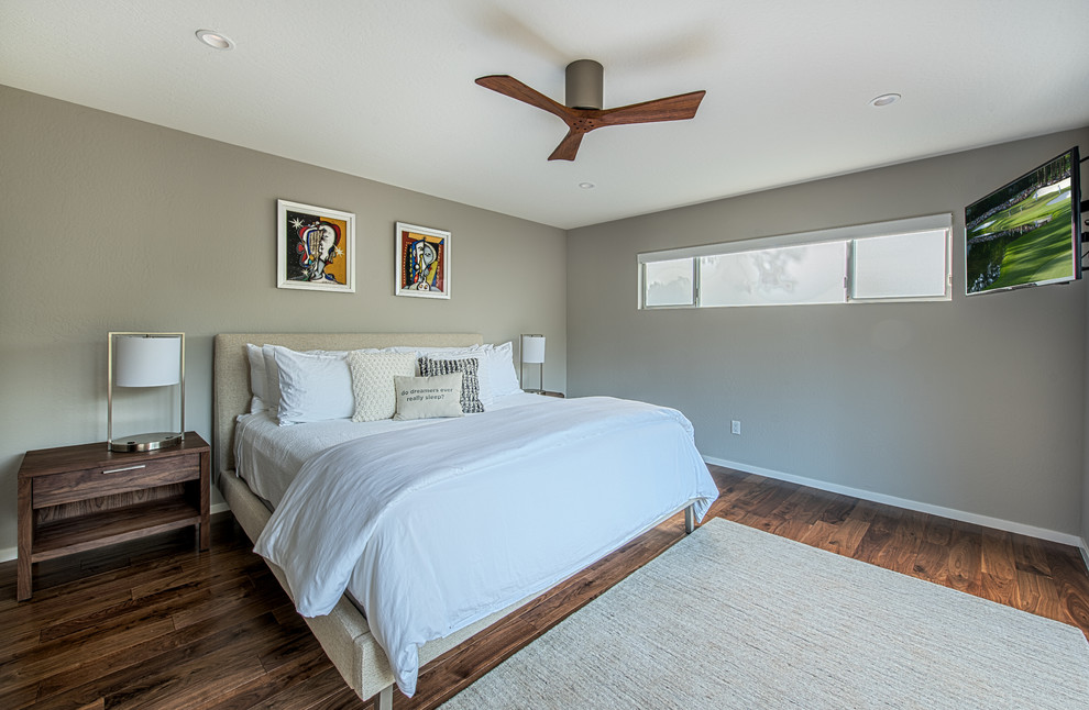 Mid-sized 1960s master medium tone wood floor bedroom photo in Other with gray walls