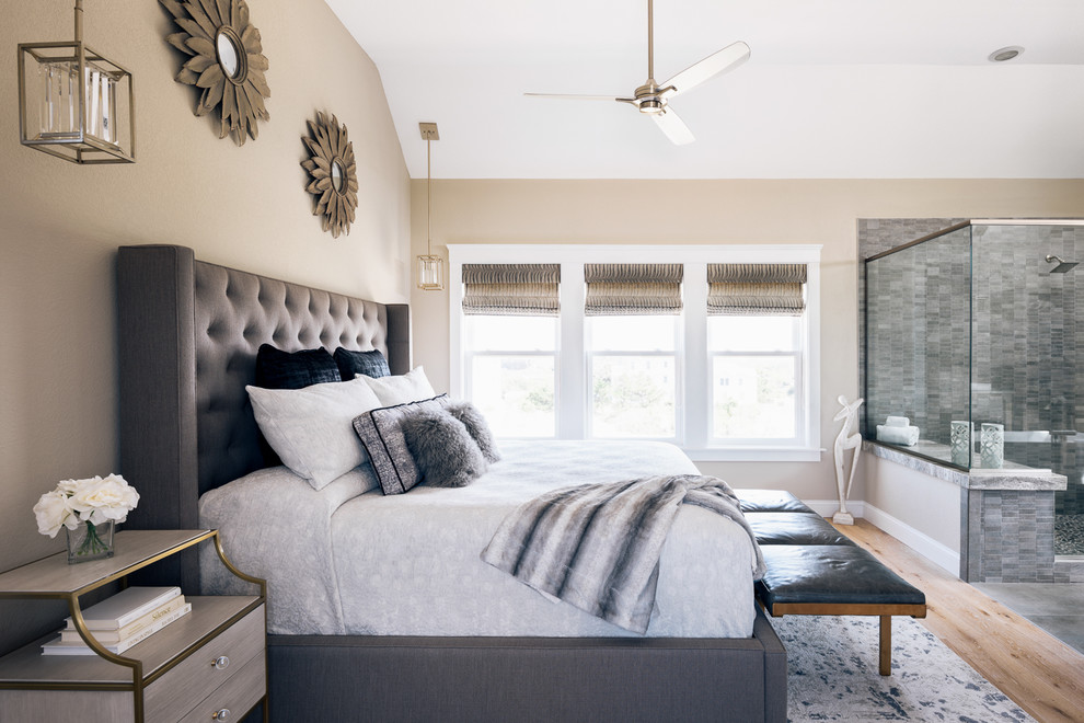 Mid-sized minimalist master light wood floor and brown floor bedroom photo in Other with beige walls and a two-sided fireplace