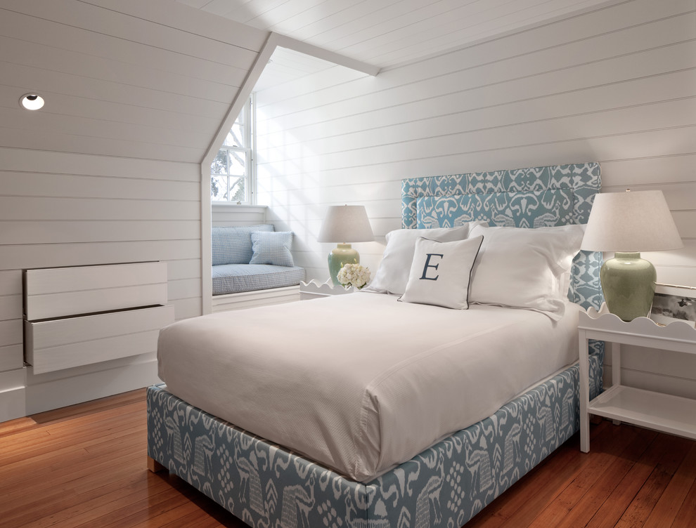 Inspiration for a mid-sized coastal medium tone wood floor bedroom remodel in Providence with white walls