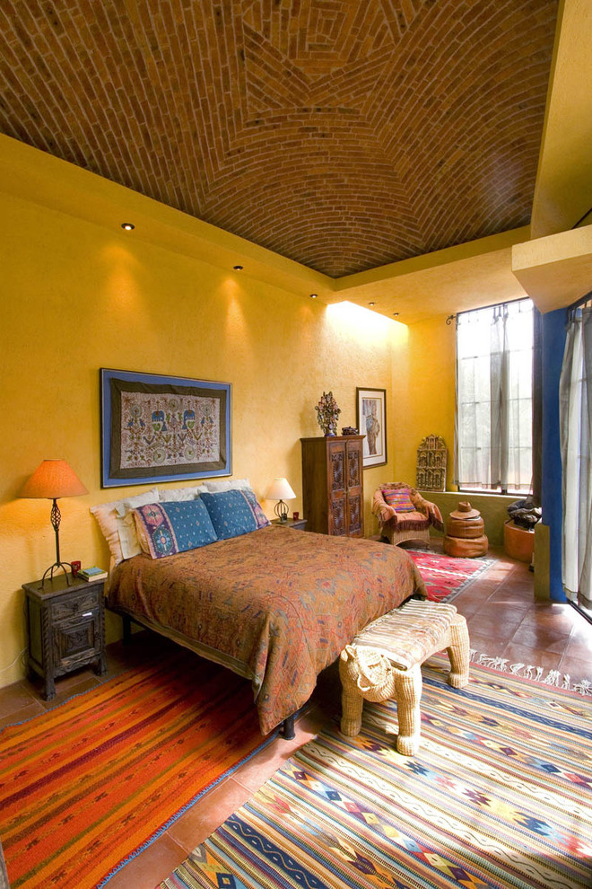 Example of a southwest bedroom design in Mexico City with yellow walls