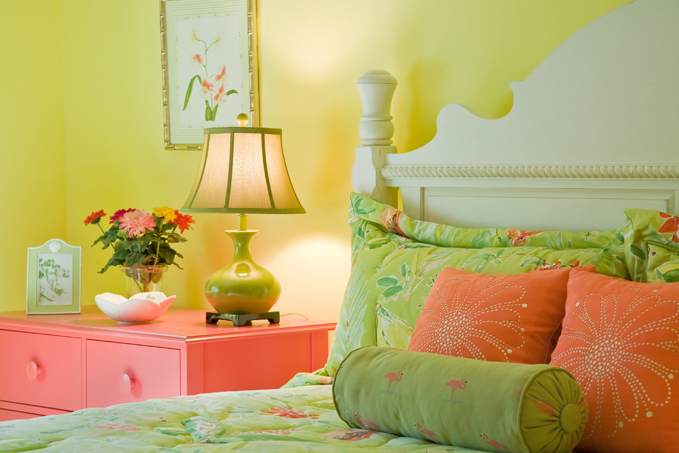 Inspiration for an eclectic bedroom remodel in Miami with yellow walls