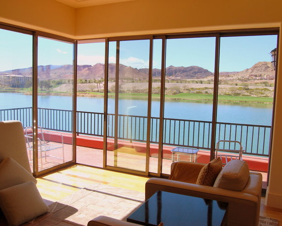 Casita in Lake Las Vegas - Panda Windows & Doors - This casita is opened up to the lake front for cool evening breezes and morning sunshine. With views of nearby mountains and wildlife, the slim profile Grand View Sliding Door System allows the homeowners to enjoy the pleasant surroundings and not feel restricted indoors. The door meets at a 90 degree corner within a total opening that is 24′ wide by 8′ high. All the panels are pocketed into the walls when the door is open.