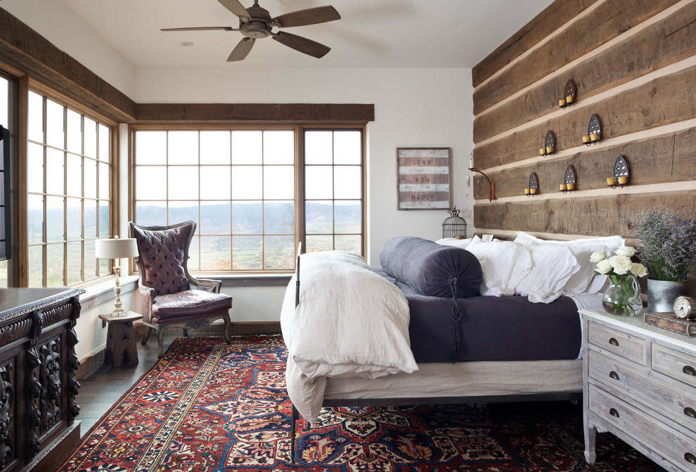 Mid-sized cottage master carpeted bedroom photo in Denver with white walls