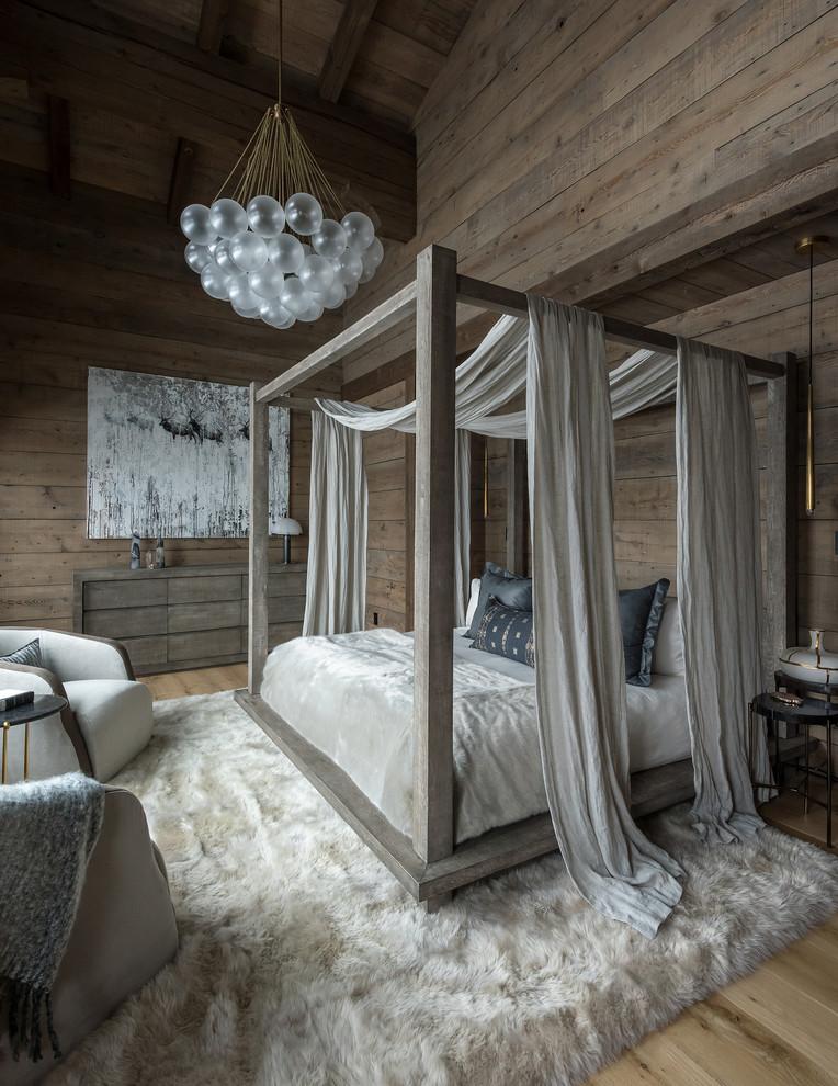 Bedroom - rustic medium tone wood floor and brown floor bedroom idea in Other with brown walls
