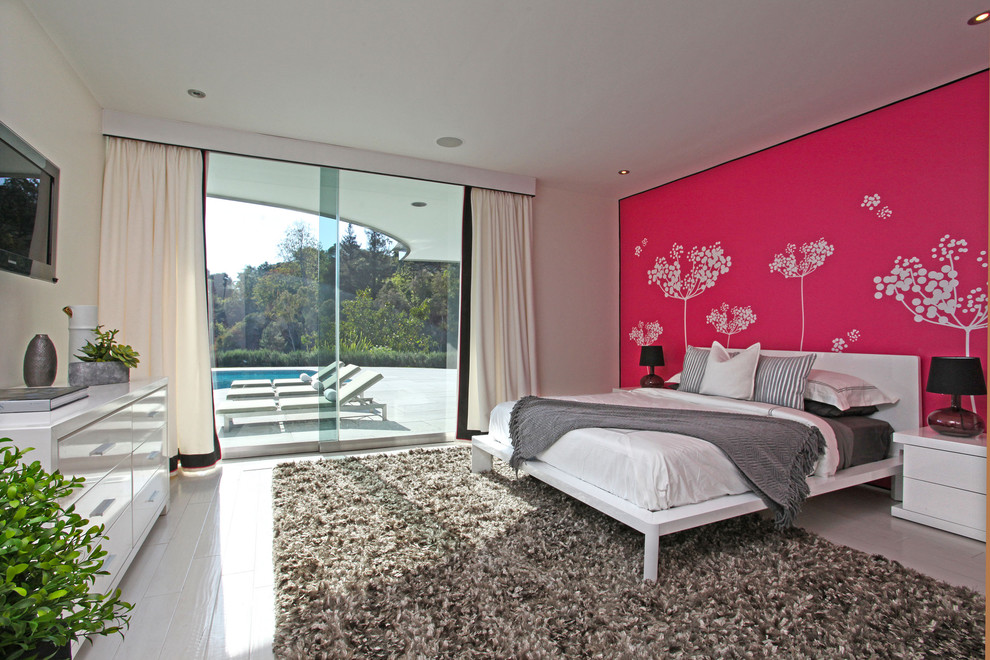 Inspiration for a mid-century modern painted wood floor bedroom remodel in Los Angeles