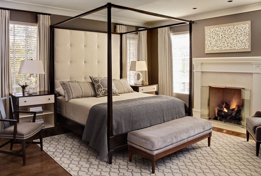 Transitional dark wood floor bedroom photo in Raleigh with brown walls and a standard fireplace
