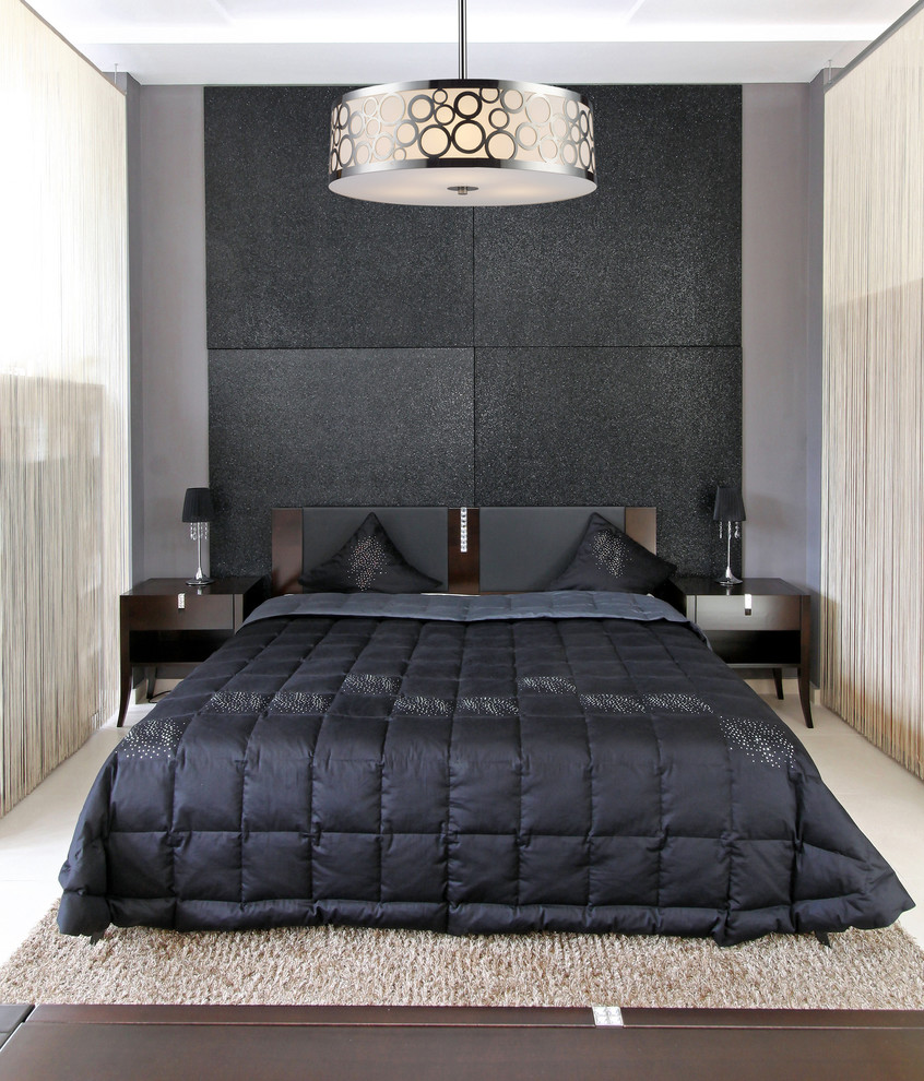 Example of a small 1950s guest light wood floor bedroom design in New York with black walls and no fireplace