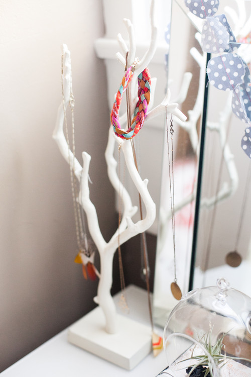 A tree branch as a jewelry holder