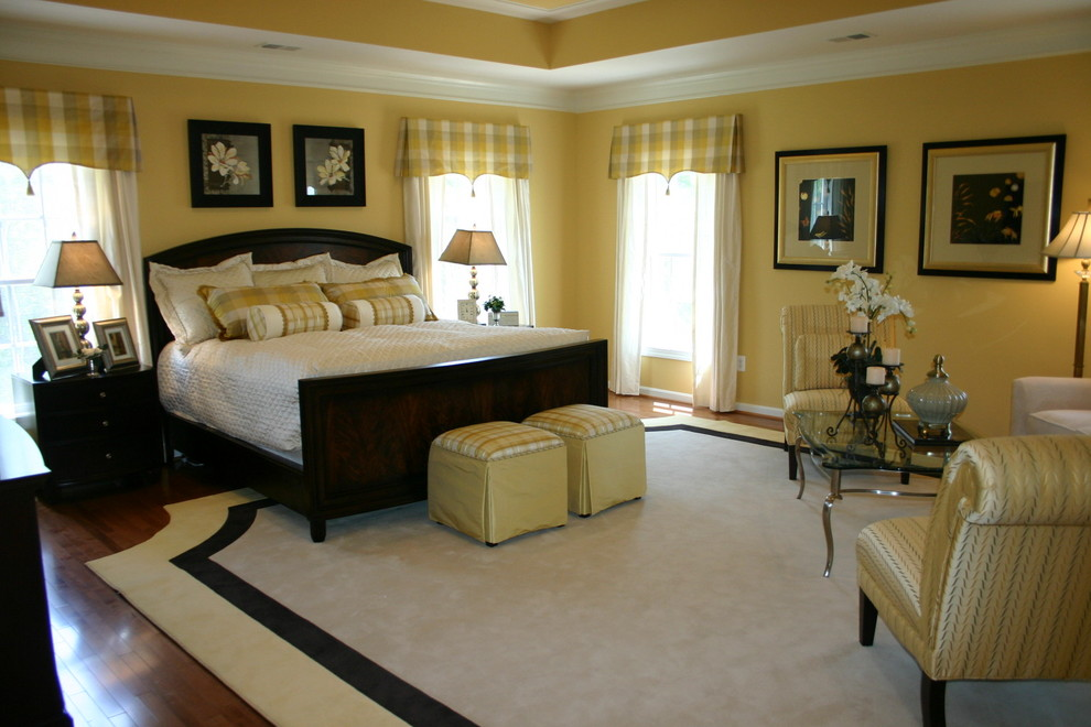 Inspiration for a timeless master dark wood floor bedroom remodel in Baltimore with yellow walls